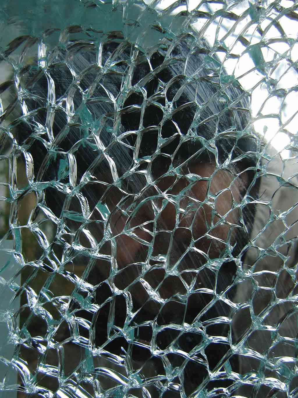 >Broken glass window photo by Wieslaw Sadurski