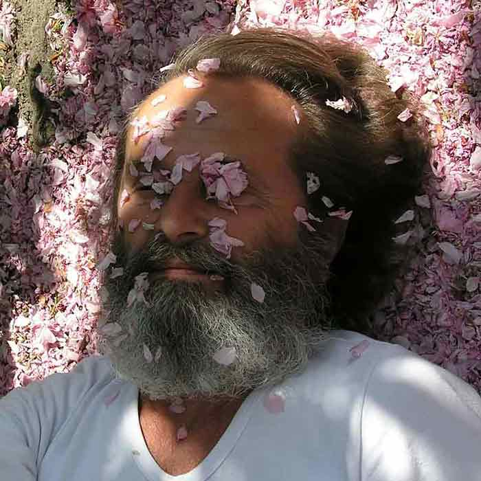 Wieslaw Sadurski photo portrait with cherry flowers petals